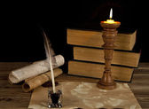 Old books with a candle — Stock Photo