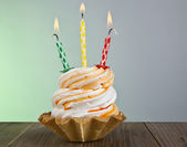Cake with a candle — Stock Photo