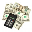 Dollars with a calculator — Stock Photo