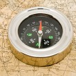 Stock Photo: Old maps and compass