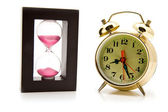 Sand-glasses and alarm clock — Foto Stock