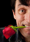 The face of the man with a rose — Stock Photo