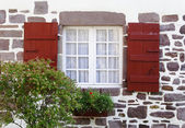 White window and red shutters — Stock Photo