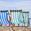 Deck chairs on Brighton beach — Stock Photo