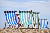 Deck chairs on Brighton beach — Stock Photo