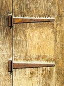 Rusty hinges on an old wooden door — Stock Photo