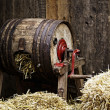 Stock Photo: Barrel-type butter churn filled with straw