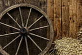 Vintage wooden carriage wheel — Stock Photo