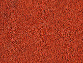 Red macadam floor — Stock Photo