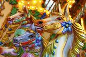 Merry-go-round horses — Stock Photo