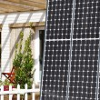 Wooden house and solar panel — Stock Photo
