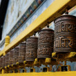 Prayer wheels at Bodhnath stupa in Kathmandu — Stock Photo #22792982