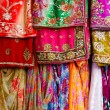 Colorful clothes and saris — Stock fotografie