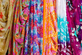 Colorful clothes and saris — Stock Photo