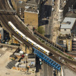 Train on a bridge in London — Stock Photo