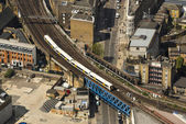 Train on a bridge in London — Stock Photo