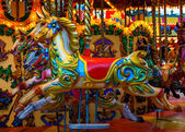 Merry-go-round horses — Stock Photo