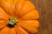 Pumpkin on wooden background — Stock Photo
