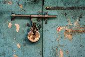 Padlock on turquoise background — Stock Photo