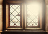 Old windows with lens flare — Stockfoto
