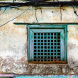 Stock Photo: Old green window and grungy wall