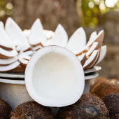 Opened coconuts on the market — Stock Photo