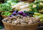 Potatoes and other vegetables for sale — Stock Photo