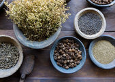 Herbs and spices in bowls — Stock Photo