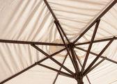Off-white parasol — Stock Photo