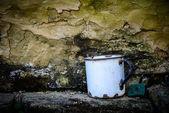 Old enamelware mug — Stock Photo