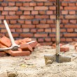 Stock Photo: Shovel and pickaxe on a construction site