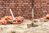 Shovel and pickaxe on a construction site — Stock Photo