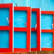 Stock Photo: Red and blue wooden shutters