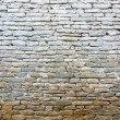 Whitewash old stone wall — Stock Photo