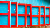 Red and blue wooden shutters — Stock Photo