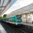 Stock Photo: Metro arriving at station in Paris