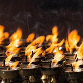Butter lamps in a buddhist monastery — Stock Photo