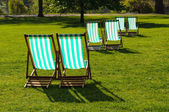 Deckchairs in a park — Stock Photo