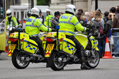 Police officers on motorbikes in London — Stock Photo