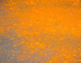 Orange powder on the floor — Stock Photo