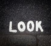 Look sign on the street — Stock Photo