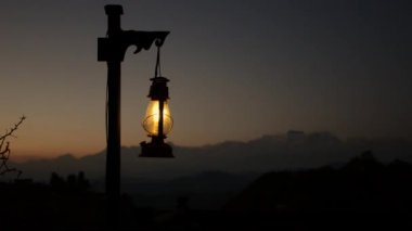 Lantern at twilight, mountain in the background — Stock Video