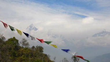 The Machapuchre and prayer flags in the foreground — Stock Video