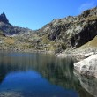 Lake Lassiedouat and peak Cadier in Pyrénées - Stock Photo