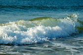 Surf on the shore of the Black Sea in the summer, sunny day — Stock Photo