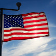 American flag against the sky at sunset evening — Stock Photo