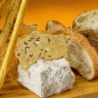Stock Photo: Assortment of baked bread on wooden plate