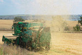 Agricultural machinery in a field, harvesting — Foto de Stock
