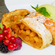 Strudel with raisins, fresh berries and ice cream — Stock Photo