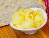 Slices of butter in a white plate — Stock Photo